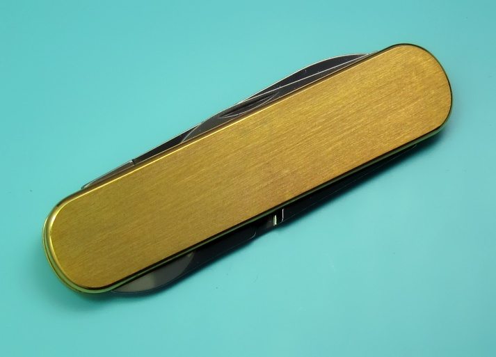 A 74mm gold plated Victorinox Ambassador with satin finish and no key-ring (0.6500.80).